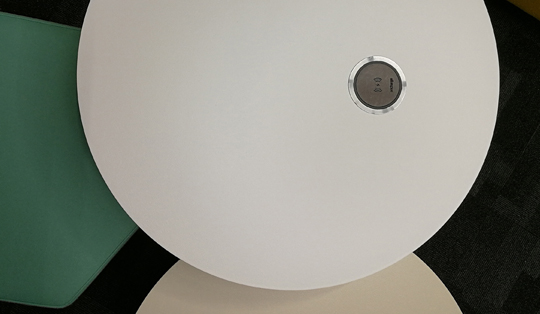 wireless charging pads on office desks